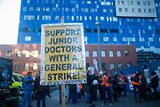 A placard calling for a general strike outside the Roayla London Hospital. Junior doctors and supporters picket the Royal London Hospital in Tower Hamlet to raise support. Junior doctors all over the country are on a one day strike against the proposed new working conditions and pay by the Government.