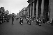 The Annual Commemorative Easter Army Parade passes the G.P.O. on O'Connell Street..18.04.1965