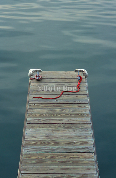 Empty boat dock with red rope