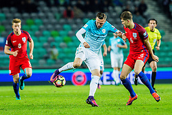 Josip Ilicic of Slovenia and John Stones of England during football match between National teams of Slovenia and England in Round #3 of FIFA World Cup Russia 2018 qualifications in Group F, on October 11, 2016 in SRC Stozice, Ljubljana, Slovenia. Photo by Grega Valancic / Sportida