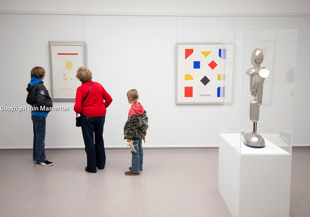 Visitors looking at art in Kroller-Muller Museum in The Netherlands