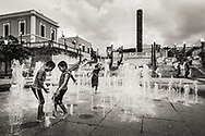 Kids play in water jets at Plaza del Quinto Centenario, in Old San Juan, Puerto Rico. ©CiroCoelho.com. All Rights Reserved.