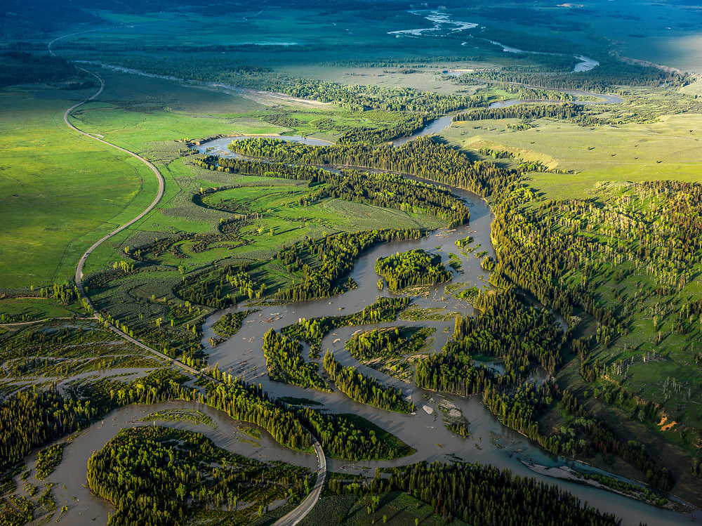 A muddy spring runoff on Pacific Creek in lower right hand corner joins the Snake River just below the Jackson Lake Dam in Teton National Park creating many different river channels. Licensing and Open Edition Prints