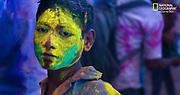Boy with holi powdered face, Lathmar Holi, Nandgaon