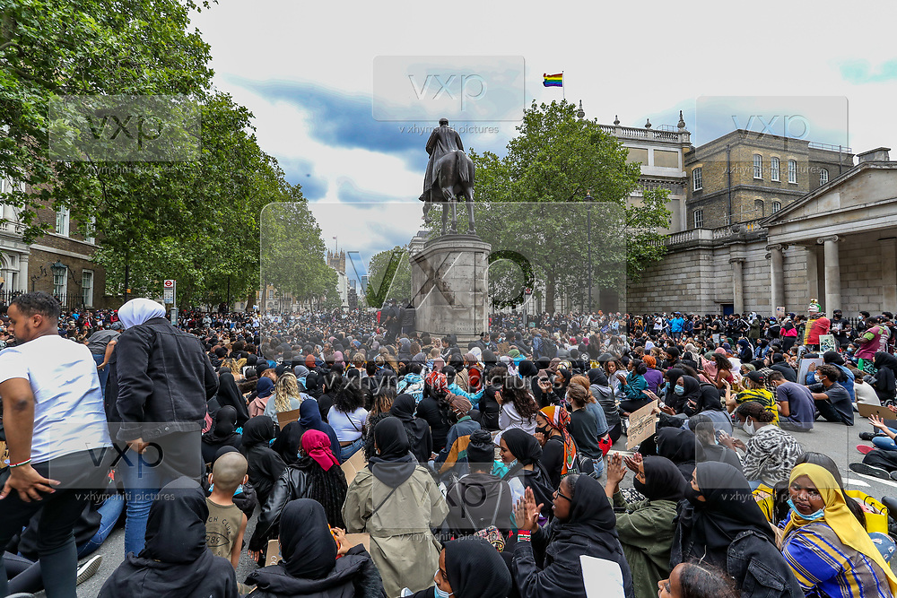 "People take part in a ""Justice for Shukri Abdi"" protest on the first anniversary of her death, Saturday, June 27, 2020, in London.<br /> The 12-year-old schoolgirl of Somali heritage, who was born in a refugee camp in Kenya, drowned in the River Irwell in Bury, Greater Manchester on June 27, 2019. Greater Manchester Police said it was treating what happened as a ""tragic incident"" and did not believe there were any suspicious circumstances. Campaigners and the mayor of Greater Manchester are pressing for a full investigation, an inquest was adjourned in February. (Photo/ Vudi Xhymshiti)"