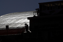 14 October 2006: The sun reflects off the dome top of Horton Field House creating a silhouette of the Hancock Field press box.&#xD;The 6th largest crowd at Hancock Stadium came to watch a game that put 8th ranked Southern Illinois Salukis against 5th ranked Illinois State University Redbirds.  The Redbirds stole the show for a Homecoming win by a score of 37 - 10. Competition commenced at Hancock Stadium on the campus of Illinois State University in Normal Illinois.<br />