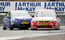 Car 28 - john George hits car 66 - Liam Griffin..British Touring Car Championship at Knockhill, Sunday 4th September 2011. .© pic Michael Schofield.