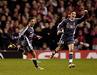 Photo: Jed Wee.<br /> Liverpool v Benfica. UEFA Champions League. 08/03/2006.<br /> <br /> Benfica's Simao Sabrosa (L), once a target of Liverpool, celebrates after his goal with former Newcastle player Laurent Robert.