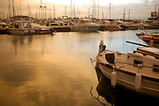 Cloudy sunset at sport port Marina Botafoch, of Ibiza, Spain, with .sailboats and fishing boats in view