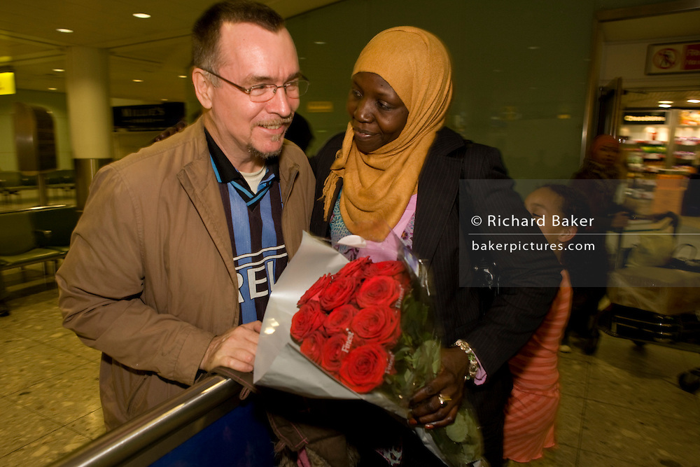 Amna Akeelo, a British citizen but originally from the village of Ed da'ein in Sudanese south Darfur, is greeted at Heathrow airport, London by her husband Noor four of her seven children: Wurwood,12; Mafuzah,5; Fatima, 9 and Zara 23 after a two-week break holiday back hom in the sudan capital, Khartoum. A frequent visitor to her homeland, Anna has opened up a shop in Loughborough, England often importing clothes and local produce.
