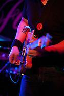 Closeup of Jon Ho playing guitar