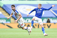 LEICESTER, ENGLAND - JULY 04: Gary Cahill of Crystal Palace clashes with Harvey Barnes of Leicester City during the Premier League match between Leicester City and Crystal Palace at The King Power Stadium on July 4, 2020 in Leicester, United Kingdom. Football Stadiums around Europe remain empty due to the Coronavirus Pandemic as Government social distancing laws prohibit fans inside venues resulting in all fixtures being played behind closed doors. (Photo by MB Media)