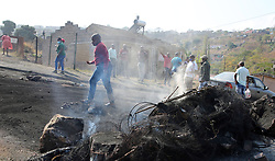 SOUTH AFRICA - Durban - 04 August 2020 - Angry Welbedacht residents caused havoc on the streets after the shooting and killing of a 28-year-old man, during a shooting between alleged suspect and a private taxi violence security company this action sparked massive protest action in Welbedacht East, on Sunday and Monday.<br /> Picture: Motshwari Mofokeng/African News Agency (ANA)