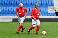 Tommy Charlton of England over 60's and Spencer Pratten (Captain) of England over 60's during the world's first Walking Football International match between England and Italy at the American Express Community Stadium, Brighton and Hove, England on 13 May 2018. Picture by Graham Hunt.