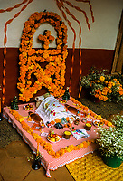 Altars for Night of the Dead (November 1), Noche de Muertos, Patscuaro, Michoacan, Mexico. Traditions connected with the holiday include building private altars called ofrendas, honoring the deceased using calaveras, aztec marigolds, and the favorite foods and beverages of the departed, and visiting graves with these as gifts.