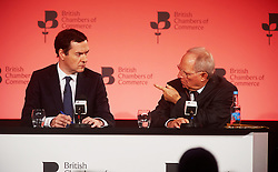 © Licensed to London News Pictures. 03/03/2016London UK. Chancellor George Osborne on stage with German Federal Minister of Finance, Wolfgang Schauble at The British Chamber of Commerce Annual Conference at The QE ll Conference Centre, Westminster.<br /> Photo credit : Simon Jacobs/LNP