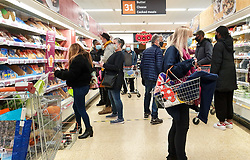 """© Licensed to London News Pictures. 22/12/2020. London, UK. Shoppers in Sainsbury's supermarket in north London buying festive groceries and food items, just three days before Christmas day. A number of supermarkets have warned that some items may run low this week. Prime Minister Boris Johnson urged in a press conference for people to """"shop normally"""". It came after France closed the borders - banning UK travellers to their country, to stop the spread of the new variant of Covid-19. Photo credit: Dinendra Haria/LNP"""