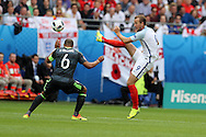 Harry Kane of England ® takes on Ashley Williams of Wales.UEFA Euro 2016, group B , England v Wales at Stade Bollaert -Delelis  in Lens, France on Thursday 16th June 2016, pic by  Andrew Orchard, Andrew Orchard sports photography.