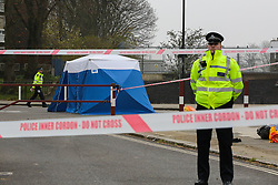 © Licensed to London News Pictures. 02/04/2019. London, UK. A police officer guards the crime scene on Grafton Road, junction with Vicars Road in Kentish Town, north west London where a man in his 20s was found stabbed around 8.30pm on Monday 1 April 2019. He was pronounced dead at the scene. Photo credit: Dinendra Haria/LNP