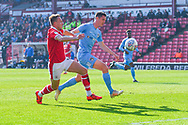Cauley Woodrow of Barnsley (9) and Dominic Hyam of Coventry City (15) in action during the EFL Sky Bet League 1 match between Barnsley and Coventry City at Oakwell, Barnsley, England on 30 March 2019.