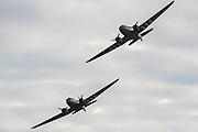 Dakotas fly past - Duxford Battle of Britain Air Show taking place during IWM (Imperial War Museum) Duxford's centenary year. Duxford's principle role as a Second World War fighter station is celebrated at the Battle of Britain Air Show by more than 40 historic aircraft taking to the skies.