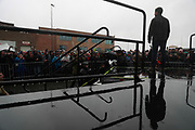 Standing in the rain South Bend, Indiana Mayor Pete Buttigieg talks to the overflow crowd standing in the rain before he announces that he's running for president of the United States in the 2020 election during a campaign event Sunday at Studebaker Building 84.