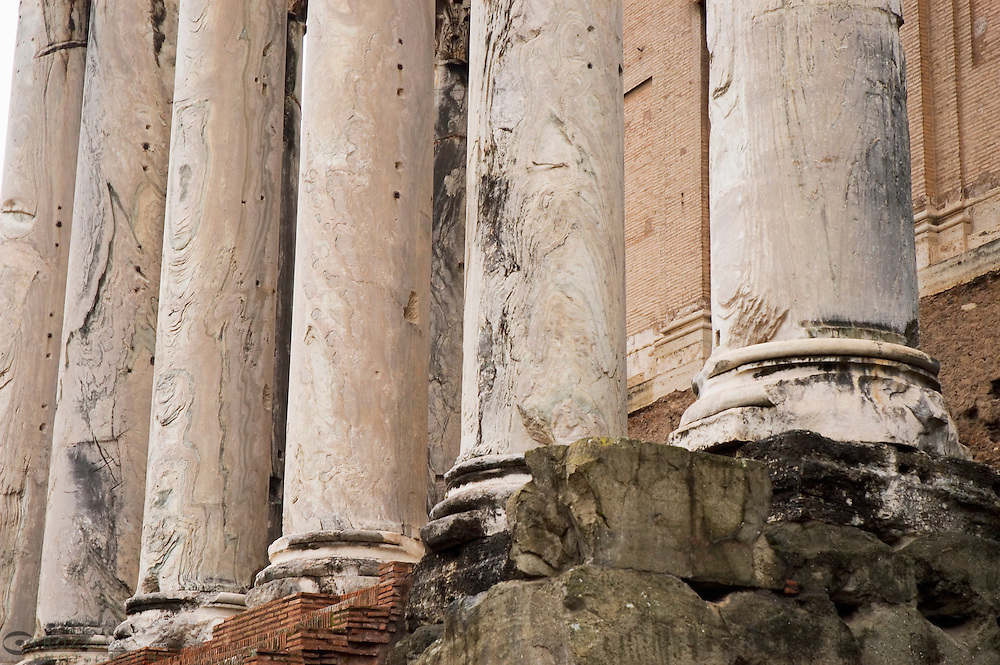 Rome Italy, a detail photo of the Temple of Antoninus and Faustina & church of San Lorenzo in Miranda in the Roman Forum...Columns ancient Roman antiquity architecture detail Rome Roma Italy Italia street ancient center roman ruins history historic column columns  marble stone facade steps stairs Center