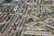 Nederland, Zuid-Holland, Den Haag, 09-05-2013; Bezuidenhout, woonwijk na het bombardement door de geaillieerden in de Tweede Wereldoorlog weer in de jaren 50 en 60 opgebouwd. Juliana van Stolberglaan (diagonaal), links Laan van Nieuw Oost-Indie, zandkleurige plein rechts midden is het Stuyvesantplein. Op de hoek linksboven de Christus Triumfatorkerk (architect Drexhage 1962).<br /> Bezuidenhout, residential area rebuilt 50 and 60 in the years after the bombing by the Allies in World War II.<br /> luchtfoto (toeslag op standard tarieven)<br /> aerial photo (additional fee required)<br /> copyright foto/photo Siebe Swart