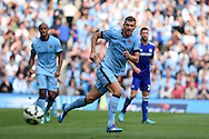 Man city's Edin Dzeko in action. . Barclays premier league match, Manchester city v Chelsea at the Etihad stadium in Manchester,Lancs on Sunday 21st Sept 2014<br /> pic by Andrew Orchard, Andrew Orchard sports photography.