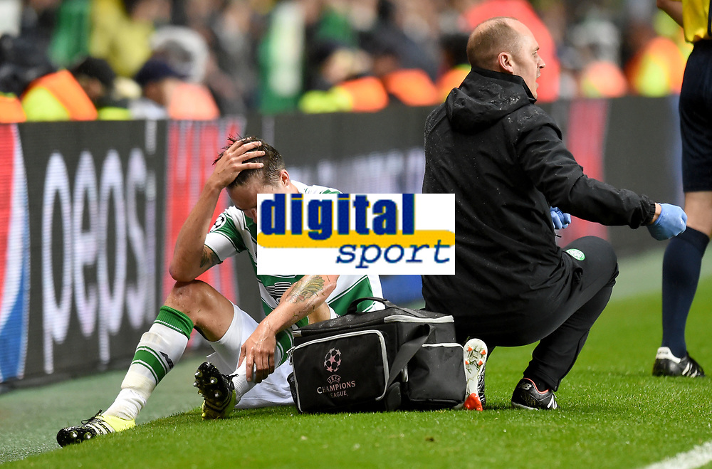 19/08/15 UEFA CHAMPIONS LEAGUE PLAY-OFF 1ST LEG<br /> CELTIC V MALMO<br /> CELTIC PARK - GLASGOW<br /> Celtic star Mikael Lustig (left) seems to be in some pain after pulling up.