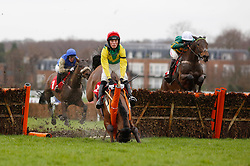 Countister and Barry Geraghty (white cap) trail Ainchea and Harry Cobden over an early flight before winning The Betfred 'Home Of Goals Galore' Novices' Hurdle Race run during Betfred Day at Sandown Park Racecourse.