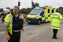 Enfield, UK. 15th September, 2021. One of two ambulances passes after Insulate Britain climate activists move out of a slip road from the M25 at Junction 25 which they were blocking as part of a campaign intended to push the UK government to make significant legislative change to start lowering emissions. The activists, who wrote to Prime Minister Boris Johnson on 13th August, are demanding that the government immediately promises both to fully fund and ensure the insulation of all social housing in Britain by 2025 and to produce within four months a legally binding national plan to fully fund and ensure the full low-energy and low-carbon whole-house retrofit, with no externalised costs, of all homes in Britain by 2030 as part of a just transition to full decarbonisation of all parts of society and the economy.