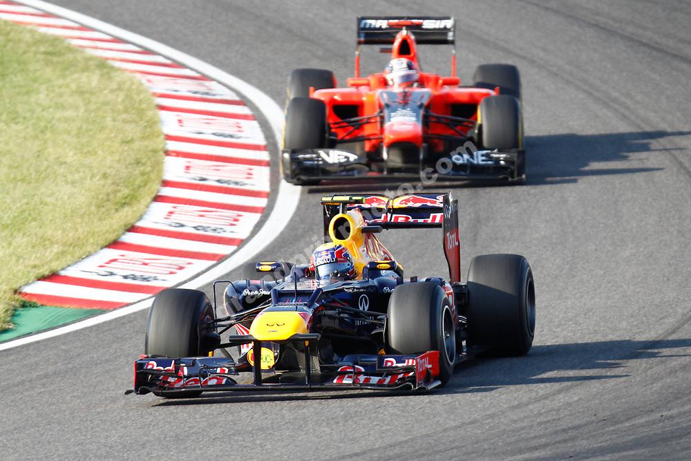 Mark Webber (Red Bull-Renault) leads Timo Glock (Marussia-Cosworth) in the 2012 Japanese Grand Prix in Suzuka. Photo: Grand Prix Photo