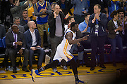Golden State Warriors forward Draymond Green (23) celebrates a basket against the Cleveland Cavaliers at Oracle Arena in Oakland, Calif., on January 16, 2017. (Stan Olszewski/Special to S.F. Examiner)