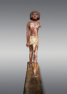 Ancient Egyptian wooden statue,  Middle Kingdom (1980-1700 BC), tomb of Shimes, Asyut. Egyptian Museum, Turin.  Grey background. .<br /> <br /> If you prefer to buy from our ALAMY PHOTO LIBRARY  Collection visit : https://www.alamy.com/portfolio/paul-williams-funkystock/ancient-egyptian-art-artefacts.html  . Type -   Turin   - into the LOWER SEARCH WITHIN GALLERY box. Refine search by adding background colour, subject etc<br /> <br /> Visit our ANCIENT WORLD PHOTO COLLECTIONS for more photos to download or buy as wall art prints https://funkystock.photoshelter.com/gallery-collection/Ancient-World-Art-Antiquities-Historic-Sites-Pictures-Images-of/C00006u26yqSkDOM