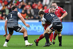 Ken Owens of Scarlets is tackled by Olly Cracknell of Ospreys<br /> <br /> Photographer Craig Thomas/Replay Images<br /> <br /> Guinness PRO14 Round 11 - Ospreys v Scarlets - Saturday 22nd December 2018 - Liberty Stadium - Swansea<br /> <br /> World Copyright © Replay Images . All rights reserved. info@replayimages.co.uk - http://replayimages.co.uk