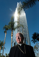 Bishop Kevin Vann, of the Diocese of Orange, stands outside the Christ Cathedral in Garden Grove Friday as it undergoes a two-year renovation to become a Catholic church.