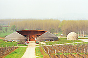 The Disznoko winery in Tokaj: the famous tractor garage built in the very typical Hungarian organic style, with vineyards. The Disznoko winery is owned by AXA Millesimes, a French insurance company. Disznoko means pig's head since a big rock in the vineyard supposedly looks like that. The new winery is impressive and a vast amount of money has been invested. Credit Per Karlsson BKWine.com