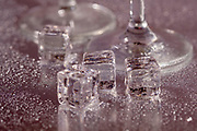 Two cocktail glasses and Ice cubes