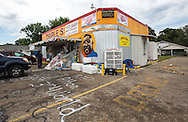 The day after three police were killed by a lone gunman who shot six officers, things are quite at the Triple S convenience store where Alton Sterling was shot dead by police in Baton Rouge, Louisiana on July 18.
