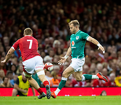 Jack Carty of Ireland kicks ahead<br /> <br /> Photographer Simon King/Replay Images<br /> <br /> Friendly - Wales v Ireland - Saturday 31st August 2019 - Principality Stadium - Cardiff<br /> <br /> World Copyright © Replay Images . All rights reserved. info@replayimages.co.uk - http://replayimages.co.uk