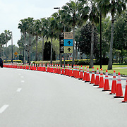 Traffic cones direct residents to a drive through testing facility for the Coronavirus (COVID-19) at the Orange County Convention Center on Friday, March 27, 2020 in Orlando, Florida. (Alex Menendez via AP)