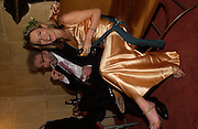 Felix Dennis with the The editor Rowan Pelling, Erotic Review Party,  Drury Lane, 26 November 2003. © Copyright Photograph by Dafydd Jones 66 Stockwell Park Rd. London SW9 0DA Tel 020 7733 0108 www.dafjones.com
