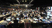 © Licensed to London News Pictures. 27/09/2011. LONDON, UK. Journalists work in one of the media rooms at The Labour Party Conference in Liverpool today (27/09/11). Photo credit:  Stephen Simpson/LNP