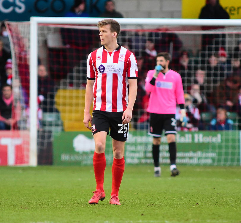 Lincoln City's Sean Raggett<br /> <br /> Photographer Andrew Vaughan/CameraSport<br /> <br /> The EFL Sky Bet League Two - Lincoln City v Forest Green Rovers - Saturday 30th December 2017 - Sincil Bank - Lincoln<br /> <br /> World Copyright © 2017 CameraSport. All rights reserved. 43 Linden Ave. Countesthorpe. Leicester. England. LE8 5PG - Tel: +44 (0) 116 277 4147 - admin@camerasport.com - www.camerasport.com