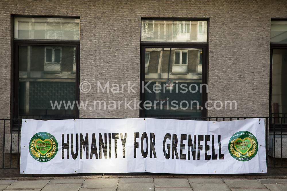 London, UK. 28 January, 2020. A banner bearing the words 'Humanity for Grenfell', the name of a community group formed to 'ensure truth, justice and restitution for all bereaved relatives and survivors of the Grenfell Tower fire', is displayed outside the venue in Paddington for the second stage of the Grenfell Inquiry which will consider how the high-rise block came to be covered in flammable materials.