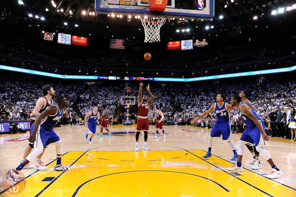 December 25, 2015; Oakland, CA, USA; Cleveland Cavaliers forward LeBron James (23) shoots a free throw during the fourth quarter in a NBA basketball game on Christmas against the Golden State Warriors at Oracle Arena. The Warriors defeated the Cavaliers 89-83.