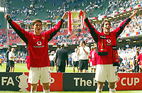 Photo: SBI/Digitalsport<br /> NORWAY ONLY<br /> <br /> Manchester United v Millwall. FA Cup Final. 22/05/2004.<br /> The two goal-scorers Christiano Ronaldo (L) and Ruud van Nistelrooy velebrate with the cup