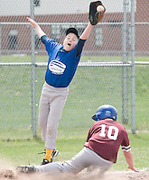 Cantin's third baseman, Patrick McKenna, makes an outstanding catch but not in time to make the out on Laconia Savings Bank's Michael Madore during their opening game played at Francouer Field in Gilford Village Saturday morning for the Cal Ripken League.  (Karen Bobotas/for the Laconia Daily Sun)