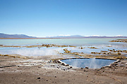 Hot spring pools steaming. Salar Uyuni salt flats and Eduardo Avaroa national park, south western Bolivia